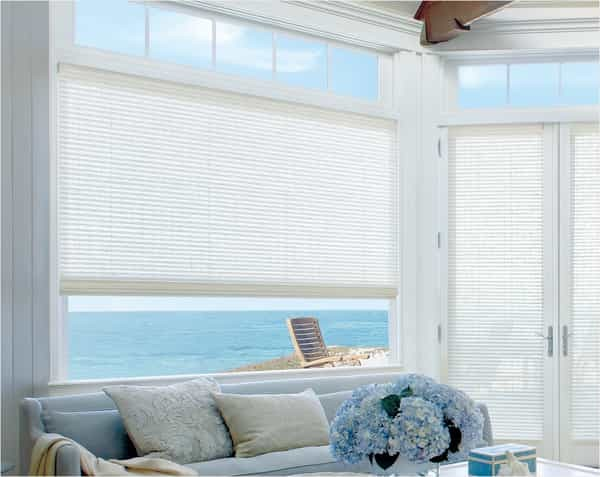 Woven Blind Living Room — Bring coastal style to your living room with woven wood natural blinds - a sandy color palette with touches of blue