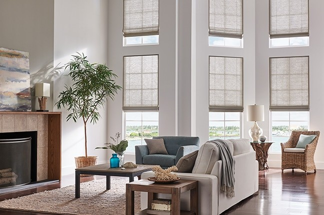 Natural Shade Roman Living — Introduce a natural touch to your living room blinds through organic materials, colors, and textures.